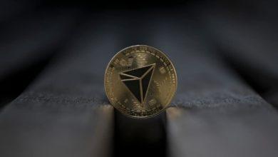 Tron cryptocurrency physical coin placed on the wooden bench 390x220 - بنیاد ترون قصد دارد توکن هایش را بازخرید کند !