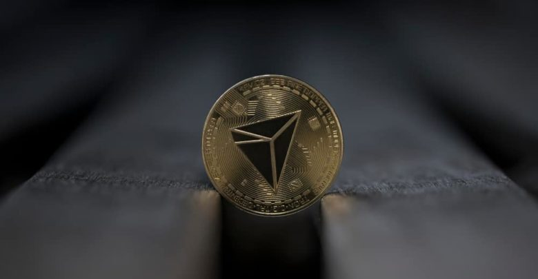 Tron cryptocurrency physical coin placed on the wooden bench 780x405 - بنیاد ترون قصد دارد توکن هایش را بازخرید کند !